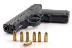 Row bullets and gun Royalty Free Stock Images