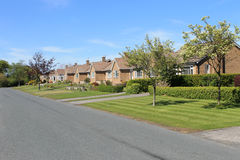 Row of bungalows in village Stock Image