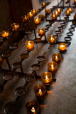 Row of burning candles Stock Photography