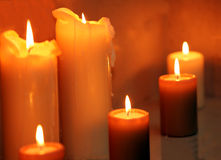 Row of burning candles Stock Images