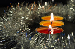 A row from burning candles and a silver decor Stock Photo