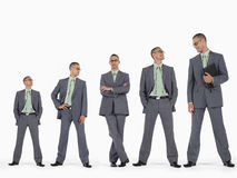 Row Of Businessmen In Ascending Order Of Height. Against white background Royalty Free Stock Photography