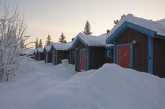 Row of cabins in the snow Stock Photography