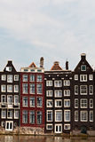 Row of canal houses in Amsterdam. Row of hisotrical canal houses in Amsterdam Royalty Free Stock Images