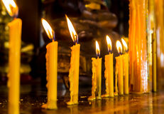 Row of candle at the buddhism temple Royalty Free Stock Photo