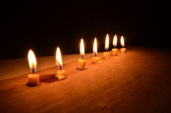 Row of candle light in the dark Stock Photos