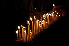 Row of candle. In night at the buddhism temple royalty free stock photography