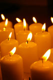 Row of candles. A row of lit candles royalty free stock photo
