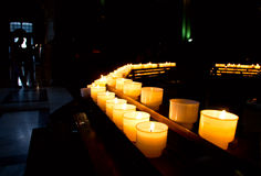 The row of candles in church Stock Image