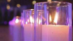 A row of candles in flasks.  stock video footage