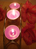 Row of candles over straw matt Royalty Free Stock Photos