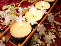 Row of candles with snowflakes Royalty Free Stock Images