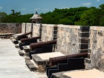 Row of cannons in a Spanish-colonial style fort in Mexico stock photography