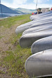 Row of Canoes at Summer Camp Stock Images