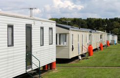 Row of caravan trailers in holiday park. With cloudscape background Stock Photography