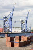 Row of Cargo containers stacked at harbor Stock Image