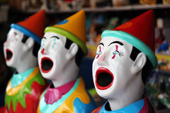 Row of carnival clowns. Row of colorful carnival clowns in a game Royalty Free Stock Photos
