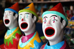 Row of carnival clowns. Row of colorful carnival clowns in a game Stock Photos