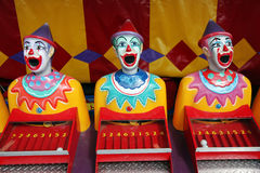 Row of carnival clowns. Row of colorful carnival clowns in a numbers game Stock Photography