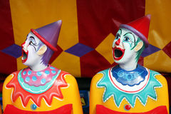 Row of carnival clowns. Row of colorful carnival clowns in a game Stock Image