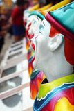 Row of carnival clowns Royalty Free Stock Photo