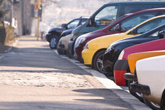 Row of cars. Row of different cars parked in a crowded city Stock Photos