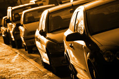 Row of Cars. Row of parked cars lit by low sunlight Stock Photography