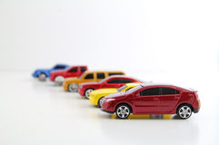 Row of cars with electric car in focus. A row of cars with a red electric car in focus Royalty Free Stock Images