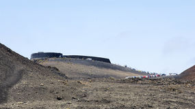 Row of cars in the landscape of the Natural Park Timanfaya. Lanzarote, Canary Islands, Spain Stock Image