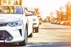 Row of cars, parked car, daylight saving time, Modern city Royalty Free Stock Photography