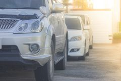 Row of cars parked on concrete floor at car parking lot with sunlight background. Royalty Free Stock Photos