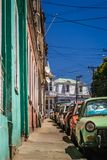 Cars parked on colorful Street in Valparaiso. Row of cars parked on the hilly street in Valparaiso, Chile, South America Stock Images