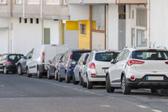 Row of cars parked on the street Stock Image