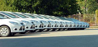Row of cars. White cars are lined up in the parking lot in one line Stock Photography