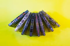 A row of cassettes on a yellow background.  stock photo