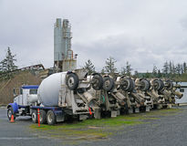 Row of cement mixer trucks Stock Image
