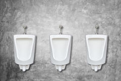 Row of ceramic outdoor urinals in men public toilet install on t Royalty Free Stock Image