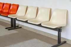 Row chair with cream and orange color royalty free stock photo