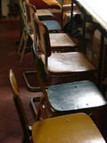 Row of Chairs. A row of old wooden chairs Royalty Free Stock Photos