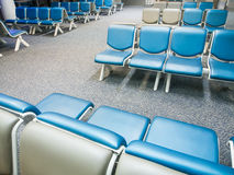 Row of chairs in airport Stock Image
