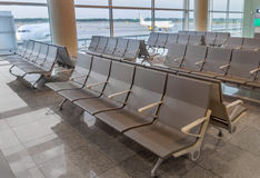 Row of chairs in Barcelona airport Royalty Free Stock Photography