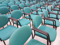 Row of chairs inside a congress room. Royalty Free Stock Photography