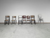 Row of chairs next to each other old retro Stock Images