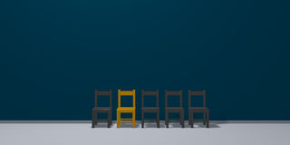 Row of chairs, one in gold Stock Photo