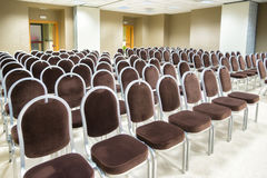 Row of chairs in presentation room Royalty Free Stock Images