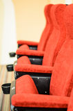 Row of chairs red in boardroom Royalty Free Stock Photos