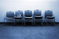 Row of chairs with skull Stock Images
