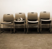 Row of chairs with skull on one Royalty Free Stock Photos