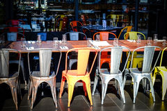 Row of chairs and tables in an empty restaurant Stock Images