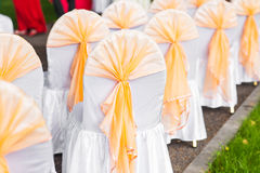 Row of chairs tastefully decorated for a part event Royalty Free Stock Image